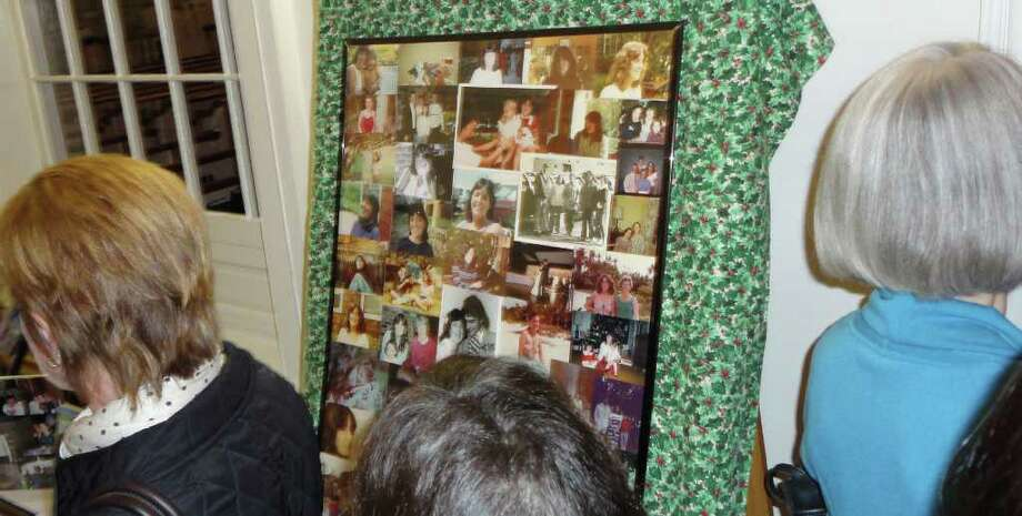 Photos from the life of Ciny D'Aiuto are displayed at a memorial service Sunday for the woman who died last week on a frigid night in a Westport parking lot. Photo: Meg Barone / Westport News freelance