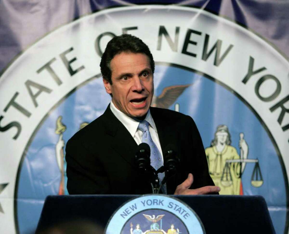 New York Attorney General Andrew Cuomo outlines legal proposals to give communities across New York state the power to reform local government during a presentation in Albany, N.Y., Thursday, Dec. 11, 2008. (AP Photo/Mike Groll)