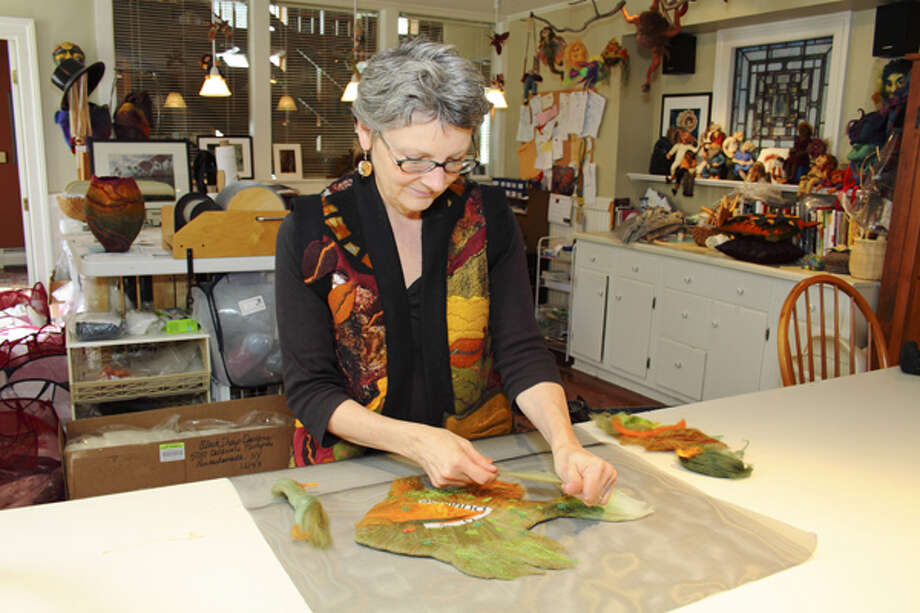 Rensselaerville-based felt artist Sharon Costello has fashioned everything from throw pillows to curtains with fibers ranging from yak hair to cat fur. Lamps are her latest fascination. (Nancy Bruno/Life@Home) Click here to read the story.