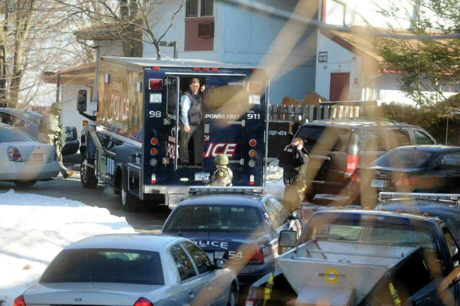 Greenwich police Special Response Unit responded to Quarry Knoll where a despondent  and unresponsive male had locked himself inside his home, on Monday, Jan.3, 2011. The two hour standoff ended without any injuries. Photo: Helen Neafsey / Greenwich Time