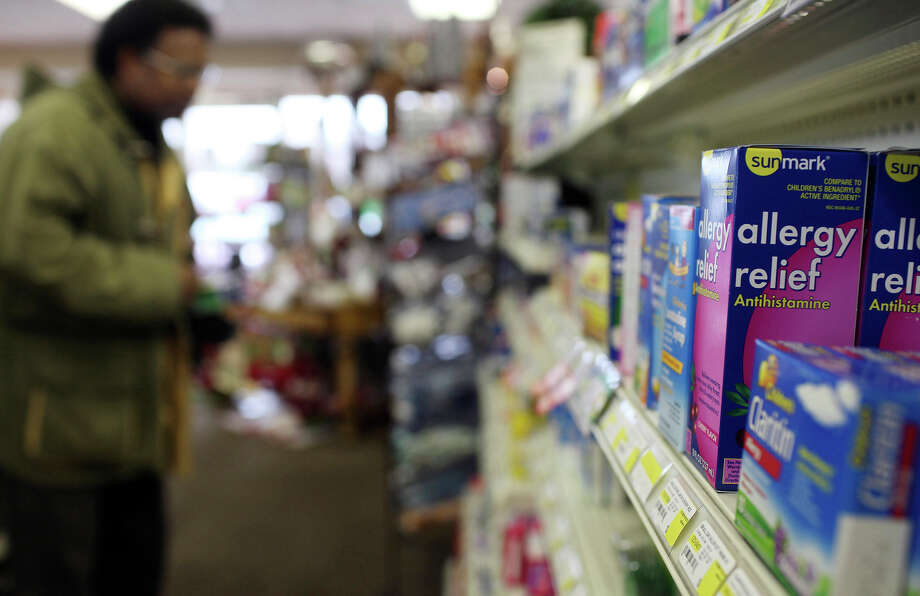 A customer shops in the cold and allergy medicine aisle oat Oakdell Pharmacy. Observers say that 2011 is shaping up to be bad year for allergy sufferers who are sensitive to mountain cedar pollen. Photo: EDWARD A. ORNELAS/eaornelas@express-news.net
