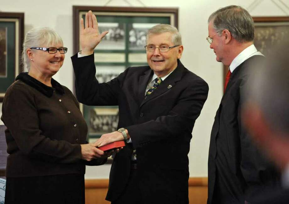 Town of Saratoga Supervisor Tom Wood is sworn in by State Supreme Court Justice Thomas Nolan as chairman of the Saratoga County Board of Supervisors in Ballston Spa on January 3, 2011. Woods' wife, Veronica, holds the Bible. (Lori Van Buren / Times Union) Photo: Lori Van Buren