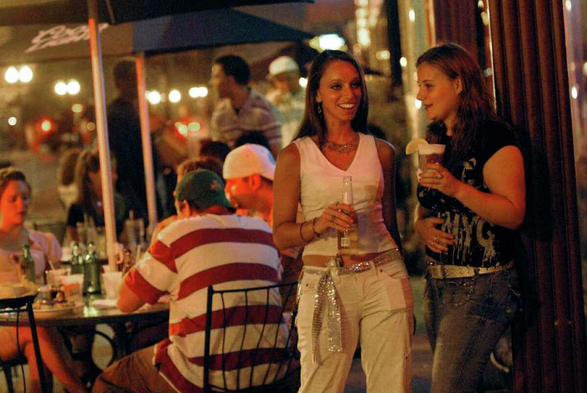 Patrons have drinks outside of Jillian's on North Pearl Street in Albany in this July 27, 2006, archive photo. (Cindy Schultz/Times Union archive)