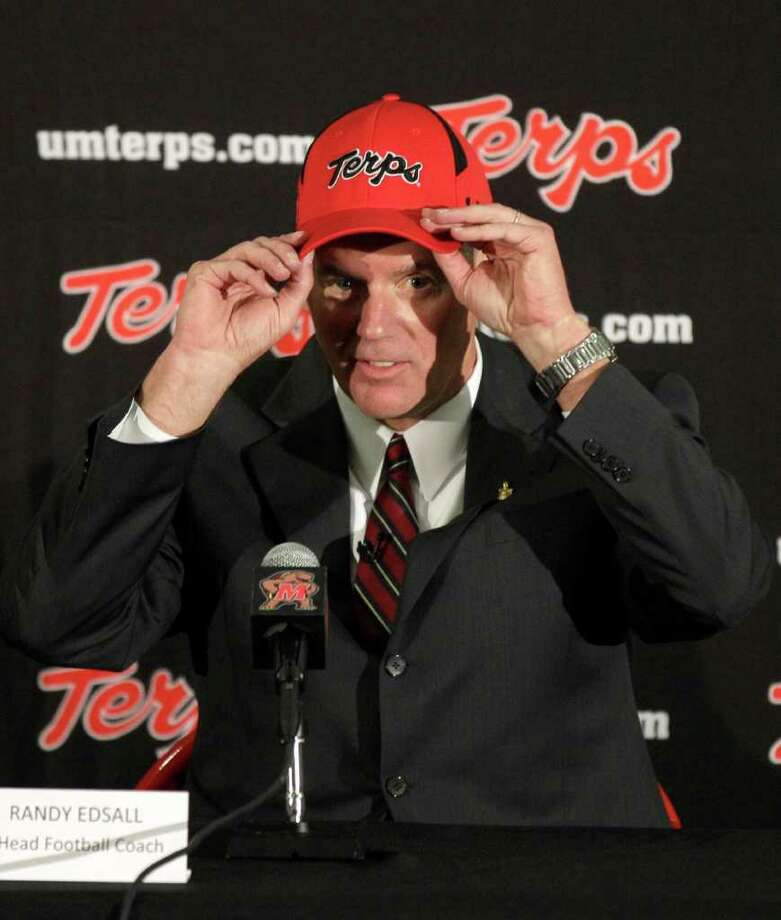 Randy Edsall puts on a University of Maryland hat after being introduced as the new head football coach at the school during a news conference, Monday, Jan. 3, 2011, in College Park, Md. (AP Photo/Rob Carr) Photo: Rob Carr, AP / Associated Press