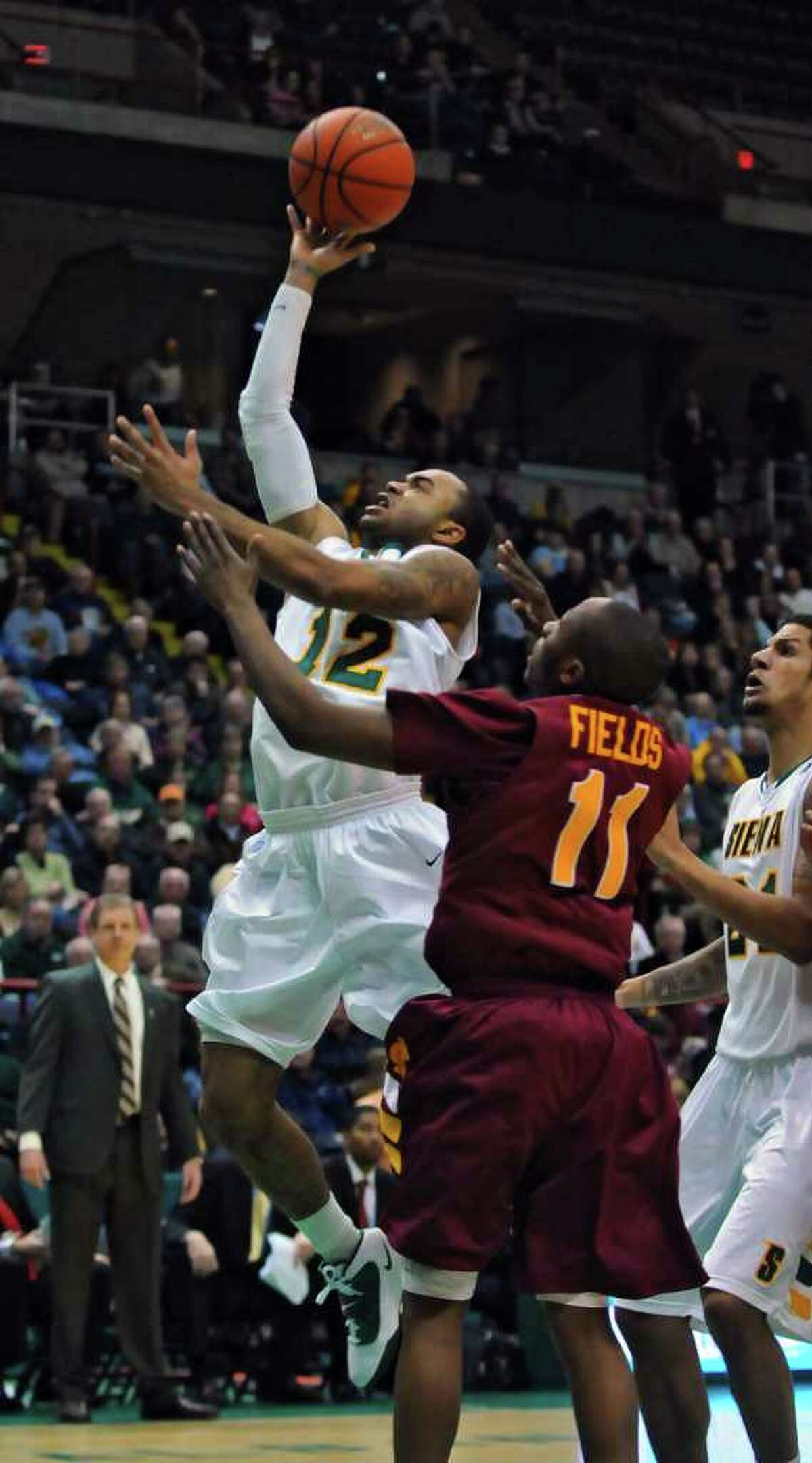 Siena College's Rakeem Brookins puts up a shot during the Saints' 73-67 men's basketball victory over Iona on Monday night at Times Union Center in Albany. The freshman point guard finished with 11 points and four assists. ( Philip Kamrass / Times Union )