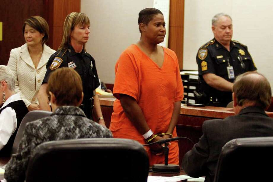 Mona Yvette Nelson, 44, appears in court Tuesday in Houston at the Harris County Criminal Courthouse. Nelson is charged with capital murder in the slaying of Jonathan Paul Foster, who vanished from his northwest Houston home about 2 p.m. the day before Christmas. (Eric Kayne/For the Chronicle) / Freelance