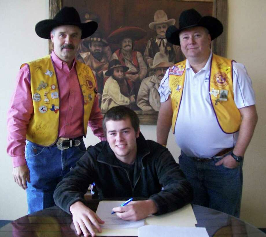 Clayton Hart signs his contract to open the Jasper Lions Club Rodeo this year. Photo: Courtesy Photo