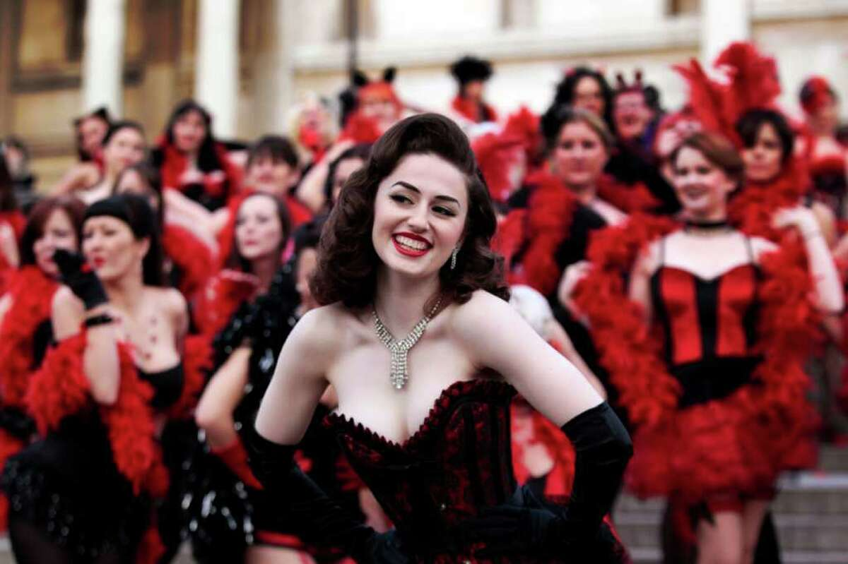 Kimberley Dunne and other burlesque enthusiasts in outfits pose for the photographers in front of the National Gallery in central London's Trafalgar Square, during a world record attempt to break what they called the World's Largest Burlesque Dance, Monday Jan. 3, 2011. (AP Photo/Lefteris Pitarakis)