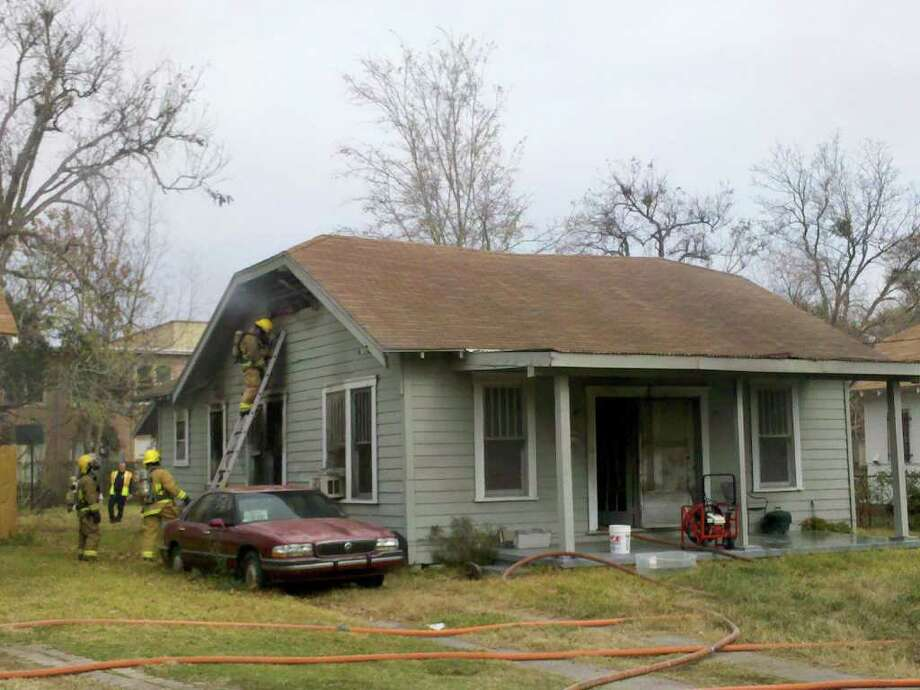Firefighters battled a fire in the 1200 block of Prairie Avenue on Tuesday morning. Teresa Mioli/The Enterprise