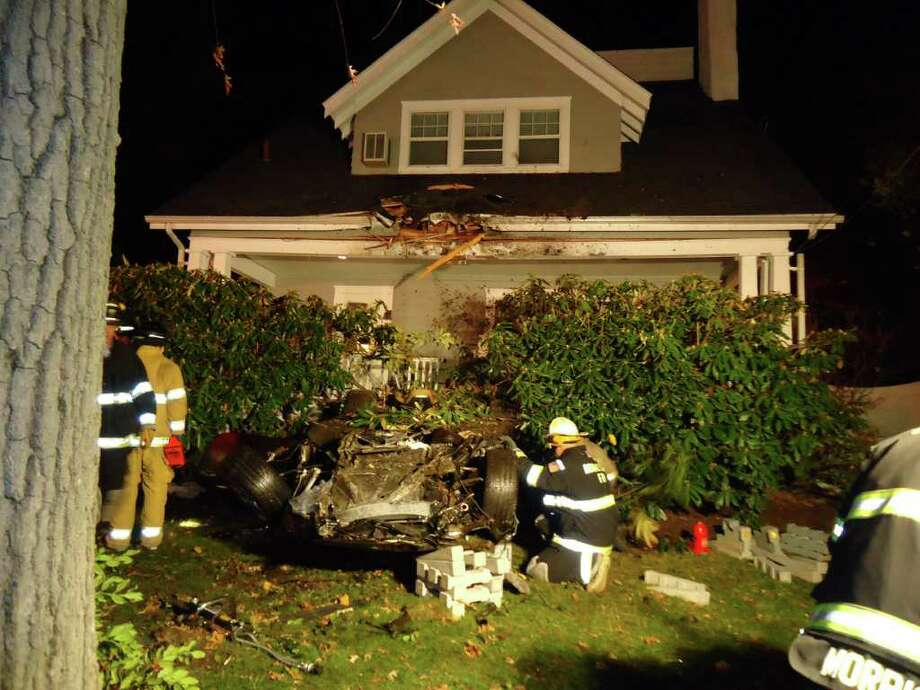 Russell Stidolph of Rowayton was charged with drunk driving Monday after launching his Porsche Carrera 35 feet in the air and crashing into the second floor of a house on Highland Avenue on Nov. 19 Stidolph was  trapped for 40 minutes until firefighters rescued him. Photo: Contributed Photo, ST / Stamford Advocate Contributed