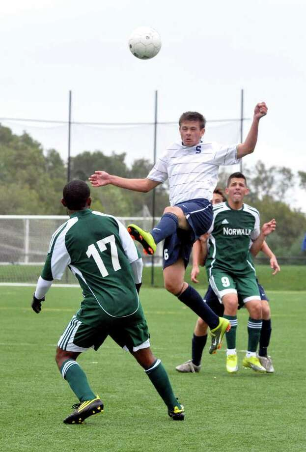 Staples' Greg Gudis goes up for a header during the boys soccer game against Norwalk at Wakeman field in Westport on Friday, Oct. 1, 2010. Photo: Amy Mortensen / Connecticut Post