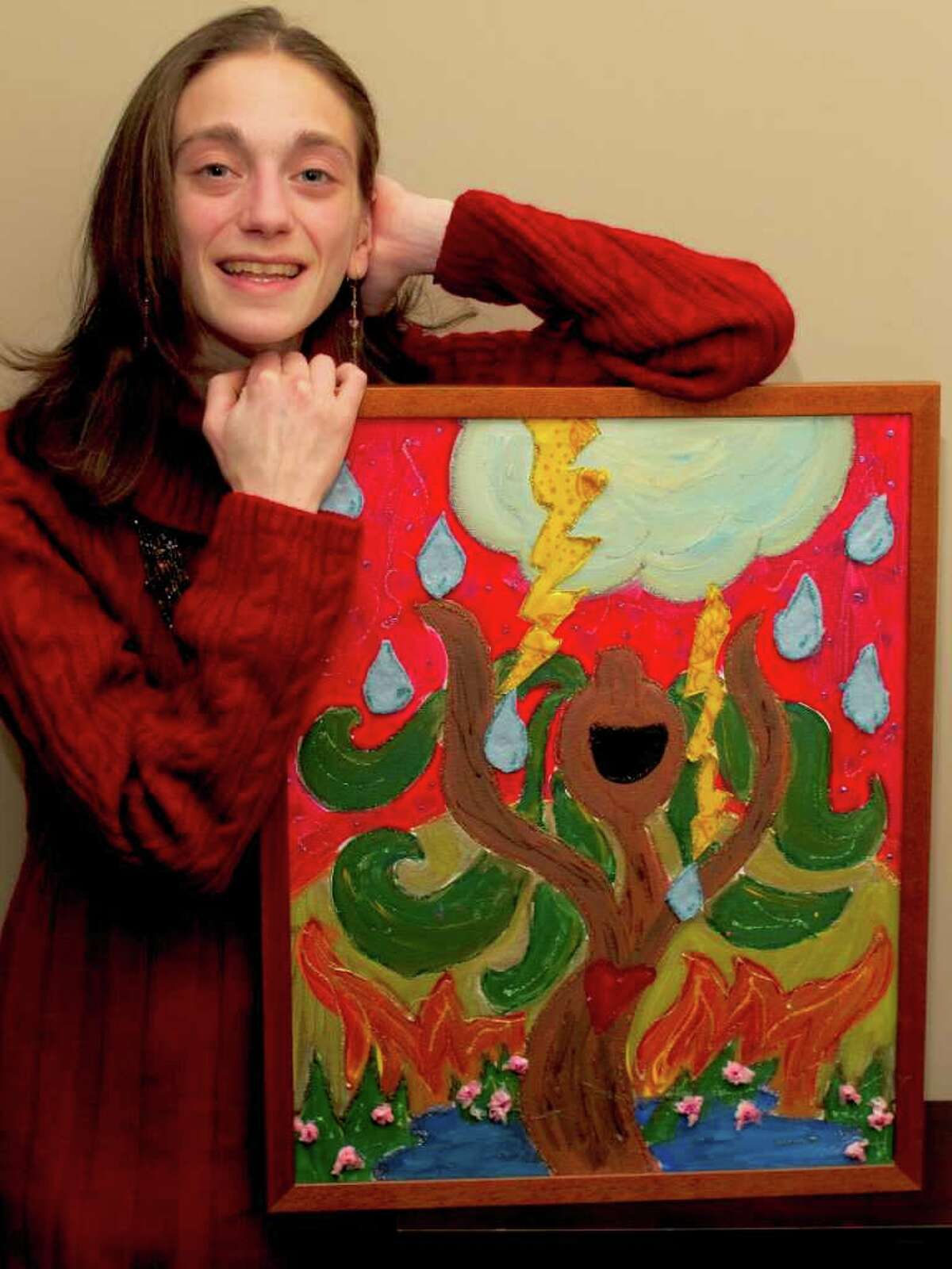 Westport artist Amy Oestreicher with one of her paintings that will be displayed Sunday in a show of her work at the Westport Woman's Club.