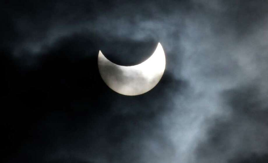 A view of a partial solar eclipse as seen from Gaza city, Tuesday, Jan. 4, 2011.  A partial solar eclipse began Tuesday in the skies over the Mideast and will extend across much of Europe. (AP Photo/Hatem Moussa) Photo: Hatem Moussa / AP
