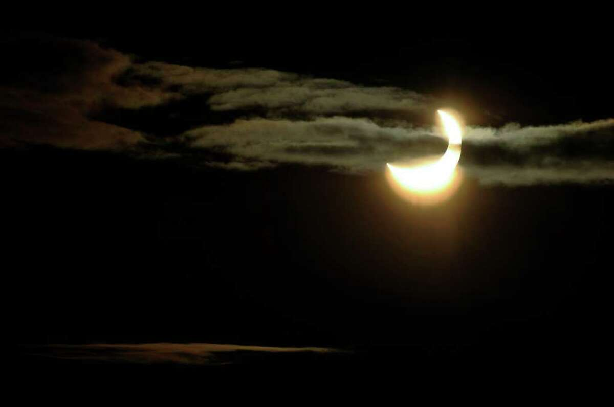 A partial solar eclipse is seen through clouds over Stockholm, Sweden, on Tuesday,Jan. 4, 2011. A sunrise eclipse was seen in Europe Tuesday morning, with the greatest eclipse expected over Sweden, where about 85 percent of the sun was to be blocked.(AP Photo/Scanpix Sweden/Anders Wiklund) SWEDEN OUT