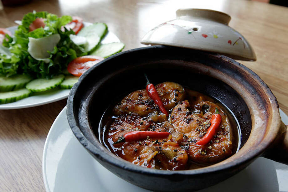 Clay Pot Fish Pho Thien An, 126 W. Rector St., Suite 108, 210-348-8526In any culture, braised dishes bring a sense of home and comfort, and this classic Vietnamese dish more than satisfies. A portion of fish is braised in fish sauce and spices. The clay pot works a little like a Dutch oven, resulting in a fish with a deep, rich and meaty flavor and texture. JERRY LARA/glara@express-news.net