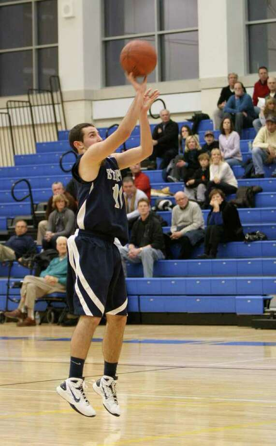 Staples senior tri-captain Jake Felman hits a jump shot in the paint on Wednesday in the Newtown Holiday Tournament championship game. Felman had 18 points and seven rebounds in a 51-49 loss to Ridgefield. Photo: Contributed Photo / Elaine Rankowitz