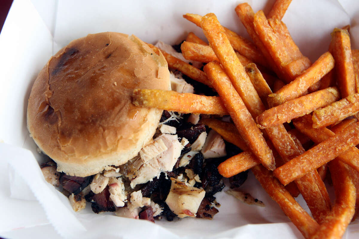 The Slop is a po boy with a little of all the meats with a side of sweet potato fries from Frontline SmokehouseHELEN L. MONTOYA/hmontoya@express-news.net