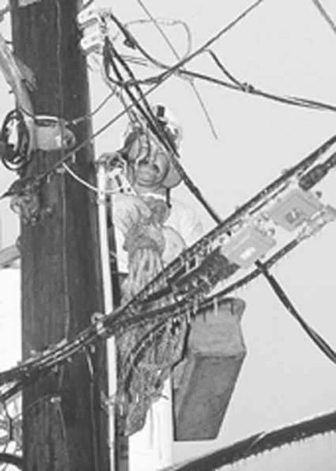Entergy linemen wrestled with power failures all over Southeast Texas during the January, 1997 ice storm. Enterprise file photo Photo: Dave Ryan / Beaumont