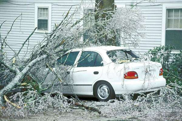 Ice laden limbs fell on this car parked in a driveway in the 900 block of Amarillo Street in Beaumont during the January, 1997 ice storm. Enterprise file photo