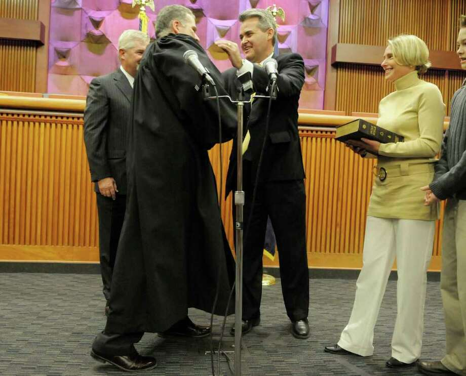 Assemblyman Steve McLaughlin, third from left, is congratulated by acting State Supreme Court Justice Craig  Doran after administering the oath during a swearing-in ceremony for the newly elected Republican members of the state Assembly at the Legislative Office Building in Albany on Tuesday, Jan. 4, 2011.  Seventeen new members were sworn in.  Also pictured is McLaughlin's wife, Maggie, right.  (Paul Buckowski / Times Union) Photo: Paul Buckowski / 00011606A