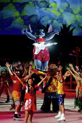 "Stitch surfs above the crowd in a scene from ""Mickey & Minnie's Magical Journey,"" which will be at the Arena at Harbor Yard for 10 performances Jan. 12-17. Photo: CONTRIBUTED PHOTO"