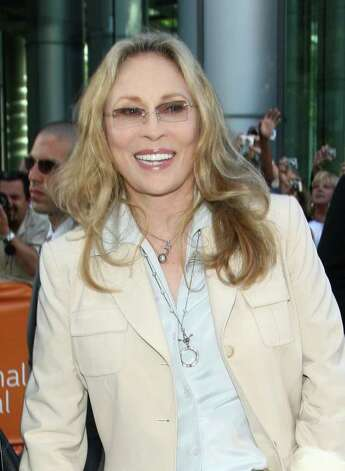 "Actress Faye Dunaway, seen here arriving at the 'Get Low' screening during the 2009 Toronto International Film Festival, is just one of the stars in Sidney Lumet's 1976 film 'Network.' This Academy Award-winning film kicks off Westport Library's ""Overcoat Film Series,"" which begins Thursday, Jan. 6. (Photo by Alberto E. Rodriguez/Getty Images) Photo: Contributed Photo / Stamford Advocate Contributed"