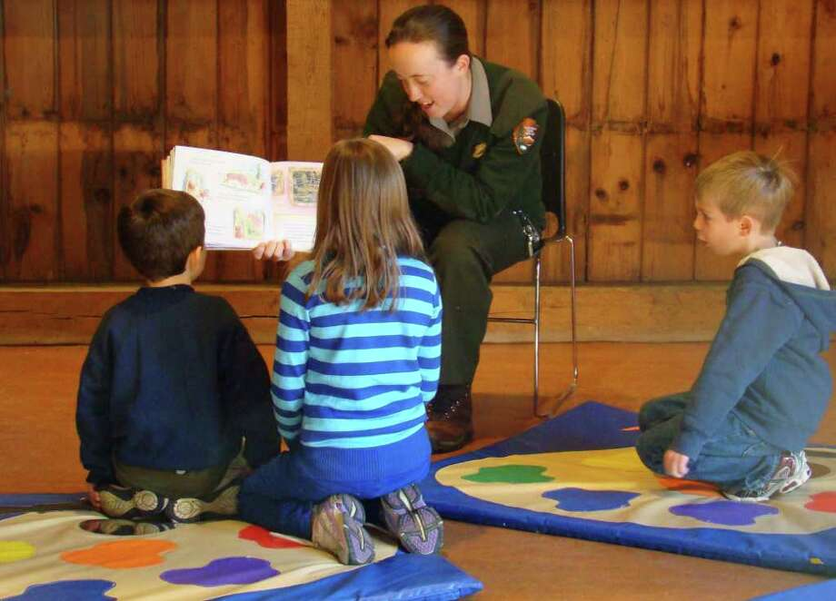 Ranger Allison Herrmann of the Weir Farm National Historic Site spends some time with some young readers as part of the site's Reading Ranger program. The next program will be Saturday, Jan. 8, when participants will learn more about protecting the past. For more information, call 203-834-1896, Ext. 13 Photo: Contributed Photo / Stamford Advocate Contributed