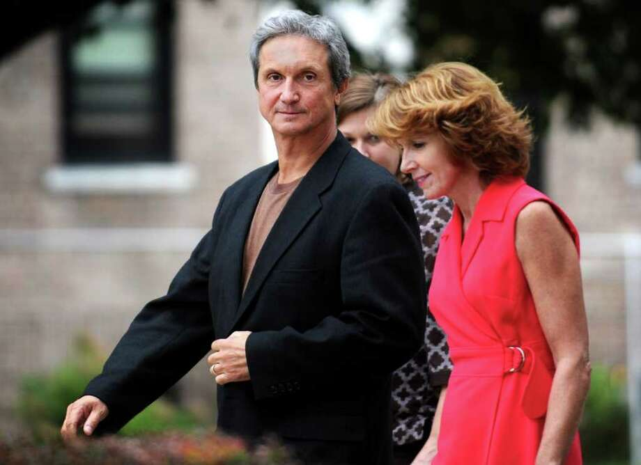 Former Danbury Hospital CFO William Roe leaves federal district court in Bridgeport  with his wife Diane after being released on bail Thursday September 9, 2010.  Roe pleaded not guilty to defrauding the hospital and another former employer out of nearly $200,000. Photo: Autumn Driscoll, ST / Connecticut Post