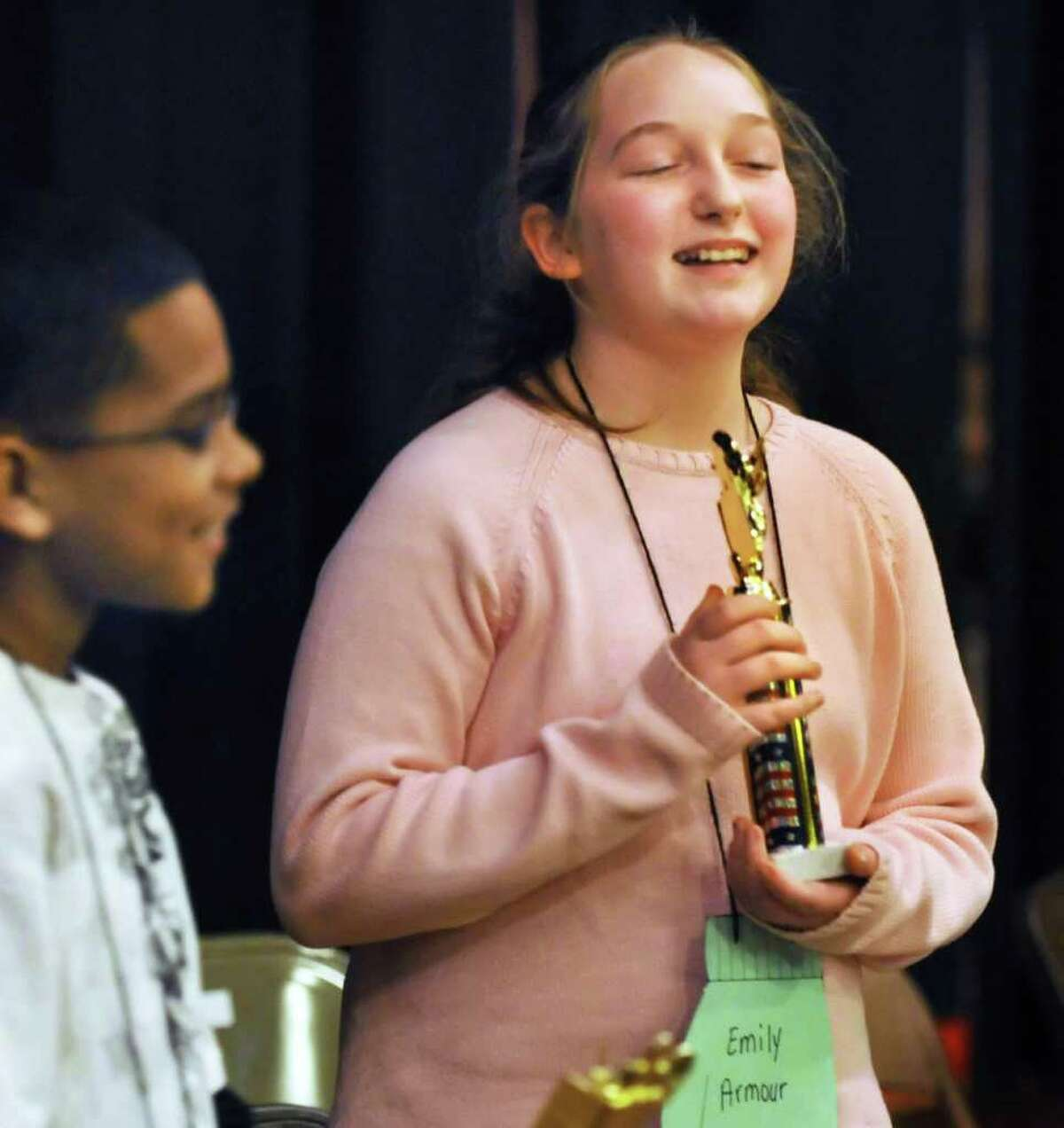 Spelling Bee winner Emily Armour of Van Corlaer Elementary School with her trophy in the Schenectady City School District Spelling Bee Tuesday afternoon January 4, 2010. (John Carl D'Annibale / Times Union)