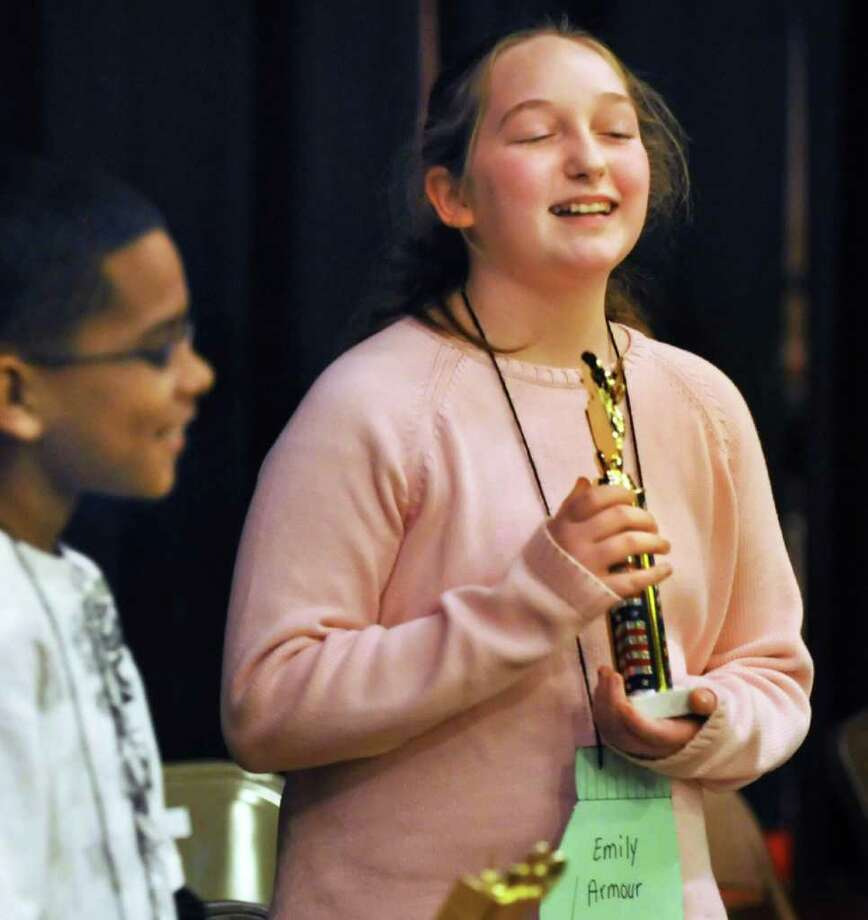 Spelling Bee winner Emily Armour of Van Corlaer Elementary School with her trophy in the Schenectady City School District Spelling Bee Tuesday afternoon January 4, 2010.  (John Carl D'Annibale / Times Union) Photo: John Carl D'Annibale / 00011627A