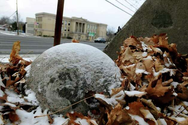 A granite ball that weighs several hundred pounds rests at the base of Eagle Hill Cemetery in Albany, N.Y. (Cindy Schultz / Times Union) Photo: Cindy Schultz