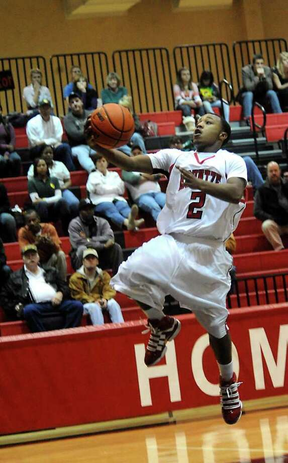 Kountze's Jamazdon Powell goes up for 2 points unchallenged during the game against East Chambers at Kountze High School in Kountze, Tuesday. Tammy McKinley/The Enterprise Photo: TAMMY MCKINLEY / Beaumont