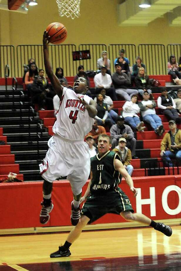 Kountze's Jonathan Warren goes up for two points aganst East Chambers at Kountze High School in Kountze, Tuesday. Tammy McKinley/The Enterprise Photo: TAMMY MCKINLEY / Beaumont