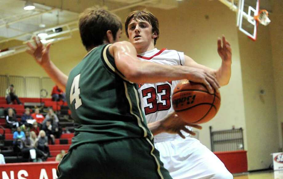 East Chambers' Hank Jones controls the ball as Kountze's Derek Puckett guards at Kountze High School in Kountze, Tuesday. Tammy McKinley/The Enterprise Photo: TAMMY MCKINLEY / Beaumont