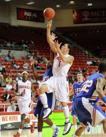 Lamar guard Mike James puts up a three point shot against Louisiana College at the Montagne Center.  Tuesday, January 4, 2010 Valentino Mauricio/The Enterprise Photo: Valentino Mauricio / Beaumont