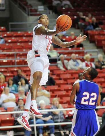 Lamar guard Kendrick Harris floats to the basket against Louisiana College at the Montagne Center.  Tuesday, January 4, 2010 Valentino Mauricio/The Enterprise Photo: Valentino Mauricio / Beaumont
