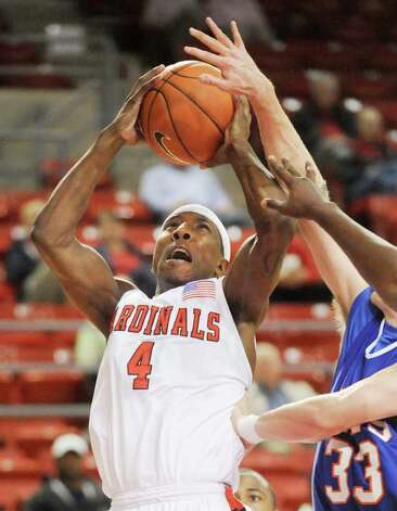 Lamar guard Devon Lamb fights for a bucket against Louisiana College at the Montagne Center.  Tuesday, January 4, 2010 Valentino Mauricio/The Enterprise Photo: Valentino Mauricio / Beaumont