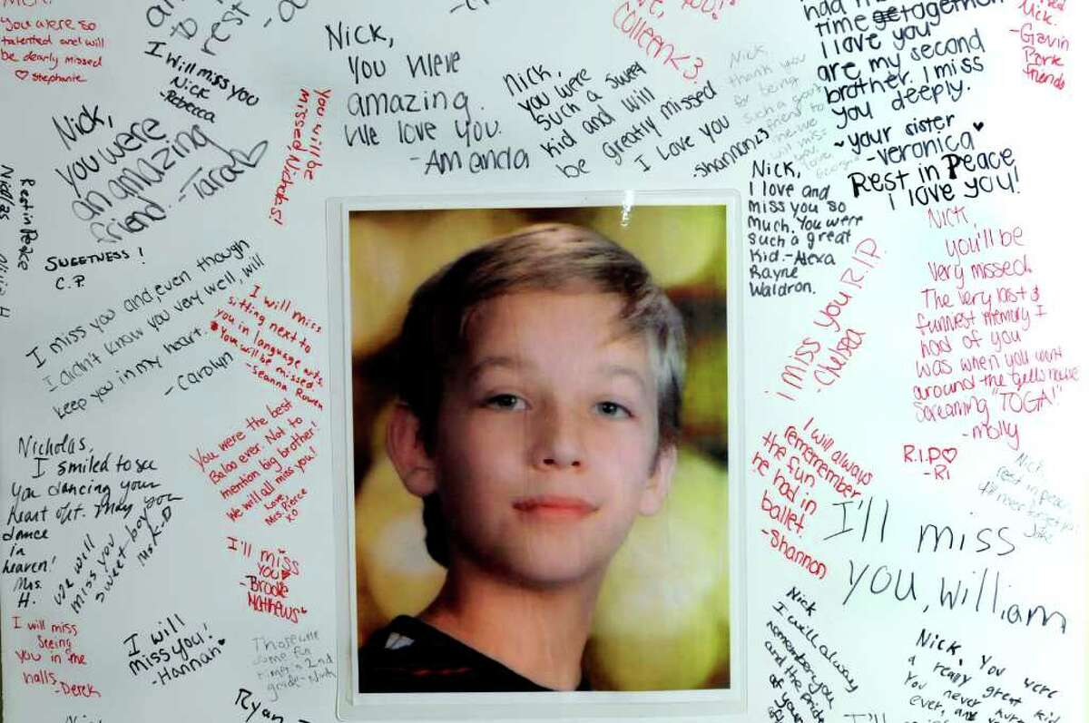 A poster of Nicholas Naumkin, who was killed Dec. 22 after a friend shot him accidentally with a handgun, with signatures from classmates and teachers on Saturday, Jan. 1, 2011, at the Naumkin home in Wilton, N.Y. (Cindy Schultz / Times Union archive)