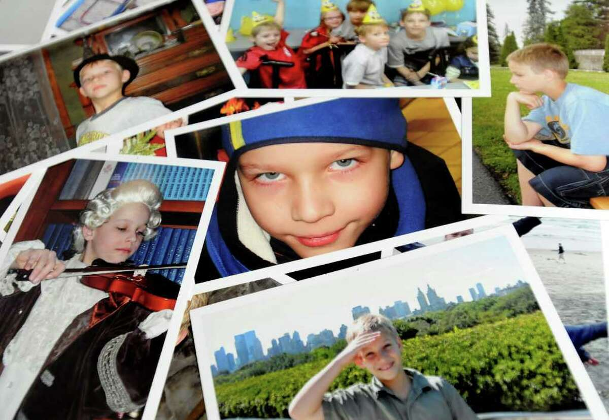 Family photographs of Nicholas Naumkin of Wilton, who was killed Dec. 22, 2010, after a friend shot him accidentally with a handgun. (Cindy Schultz / Times Union archive)