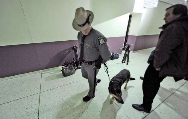 Trooper Robert Schlegel and his canine partner, Alex, conduct a search before the media is allowed to enter the Convention Center in the Empire State Plaza in Albany before Gov. Andrew Cuomo makes his first State of the State speech January 5, 2011.  (Skip Dickstein / Times Union) Photo: SKIP DICKSTEIN / 2008