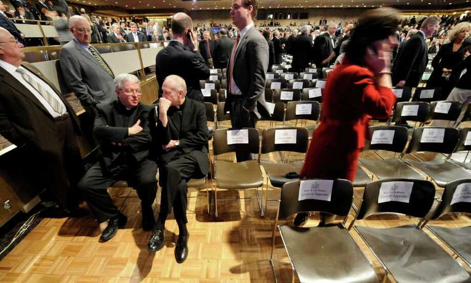Rev. Kenneth Doyle, left, and Albany Roman Catholic Diocese Bishop Howard Hubbard chat in the Convention Center of the Empire State Plaza in Albany before Gov. Andrew Cuomo's first State of the State speech January 5, 2011.  (Skip Dickstein / Times Union) Photo: SKIP DICKSTEIN / 2008