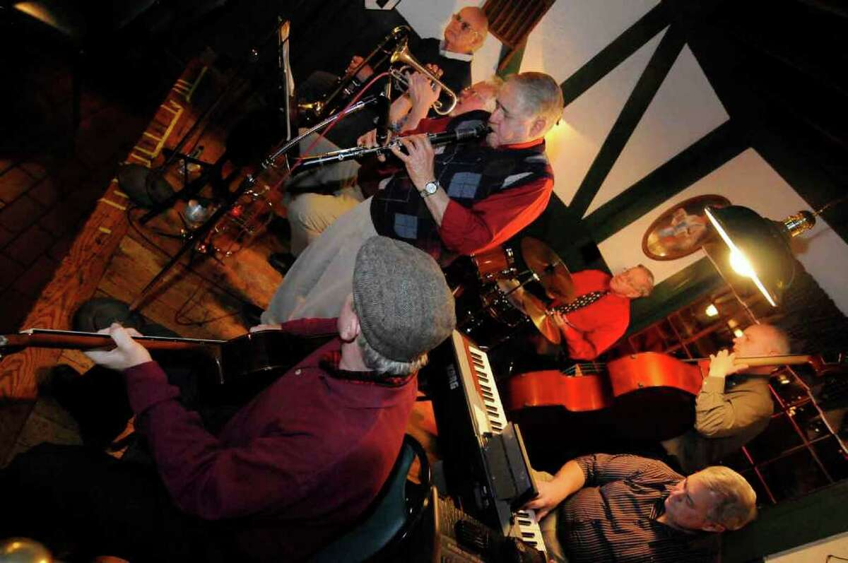 Skip Parsons, center, and his Riverboat Jazz Band take a break during a performance at Fountain Restaurant in Albany. (Michael P. Farrell / Times Union)