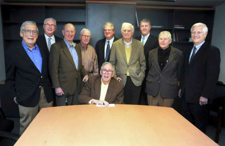 The Prognosticators is a group of local seers who get together each December to make predictions for the coming year. Members of the group gathered recently at the Greenwich Citizen offices and compared notes on their 2011 predictions. They are, from left, Roy Rowan, Brad Hvolbeck, Jack Moffly, Donald Blair, Marty Edelston (seated), Bill Ferdinand, Dr. Brooks Hoffman, the group's founder and chairman emeritus, Mike Bayles, Emerson Stone, and Quinton Friesen.  Photo: Helen Neafsey/Staff Photo, Contributed Photo / Greenwich Citizen