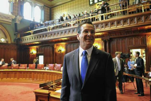 Gov.-elect Dan Malloy stops by Senate chambers before the swearing in of  Lt. Gov.-elect Nancy Wyman at the Capitol in Hartford, Conn., Wednesday, Jan. 5, 2011.  (AP Photo/Jessica Hill) Photo: AP