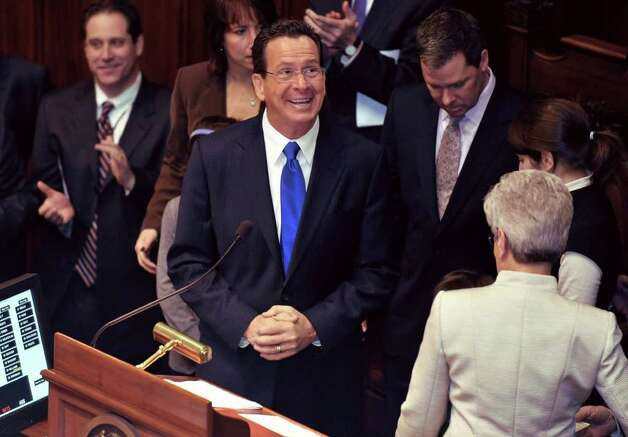Connecticut Gov.-elect Dan Malloy smiles after swearing in Lt. Gov. Nancy Wyman in Senate chambers at the Capitol in Hartford, Conn., Wednesday, Jan. 5, 2011.  (AP Photo/Jessica Hill) Photo: AP