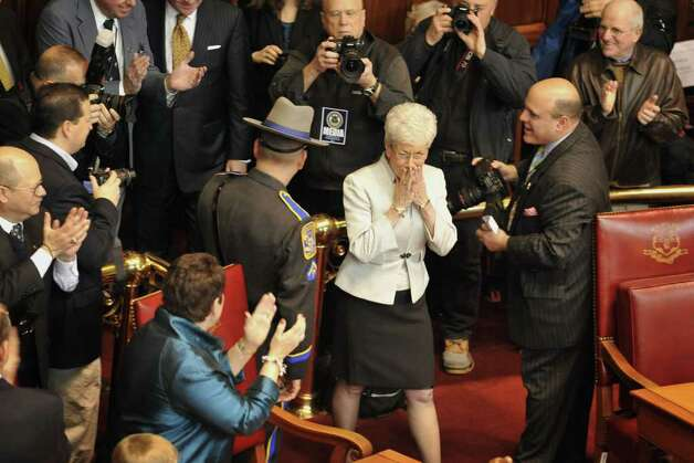 Lt. Gov.-elect Nancy Wyman reacts as she enters Senate chambers for her swearing-in ceremony at the Capitol in Hartford, Conn., Wednesday, Jan. 5, 2011.  (AP Photo/Jessica Hill) Photo: AP