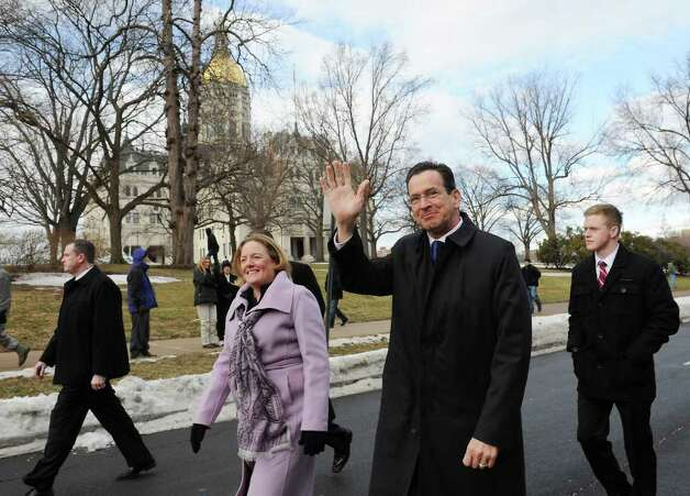 Governor-elect Dan Malloy marches with his wife Cathy Malloy during the Inaugural parade along Capitol Ave. in Hartford, Conn. on Wednesday, January 5, 2011. Photo: Kathleen O'Rourke / Stamford Advocate