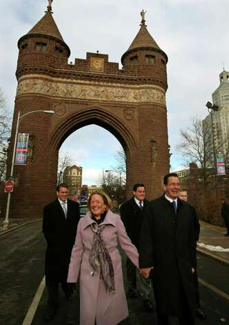 New Connecticut Governor Dan Malloy and his wife Cathy walk hand-in-hand through the Soldiers and Sailors Arch in downtown Hartford during the Inaugural Parade on Wednesday, January 5, 2011. Photo: Brian A. Pounds / Connecticut Post