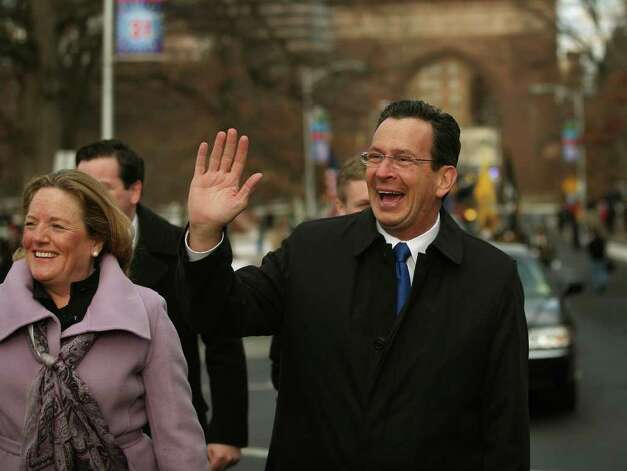 New Connecticut Governor Dan Malloy and his wife Cathy wave to supporters as they walk in the Inaugural Parade in downtown Hartford on Wednesday, January 5, 2011. Photo: Brian A. Pounds / Connecticut Post
