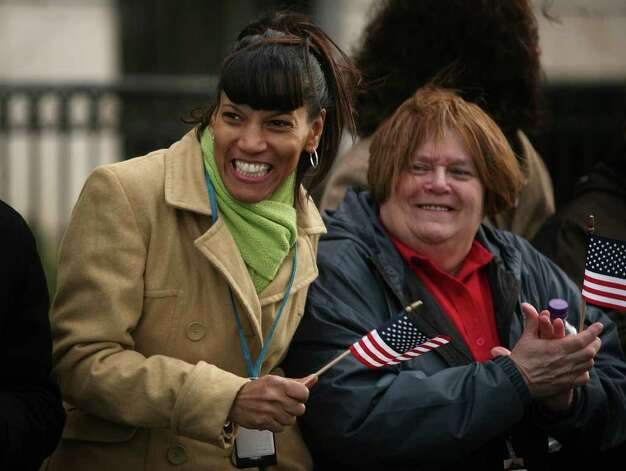 Stephanie Sheff, left of East Hartford, and Lois Dostie of New Britain, wave flags as they watch the Inaugural Parade of new Connecticut Governor Dan Malloy in downtown Hartford on Wednesday, January 5, 2011. Photo: Brian A. Pounds / Connecticut Post